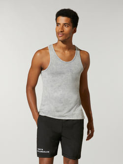 front view of male model in light grey tank top and black athletic shorts