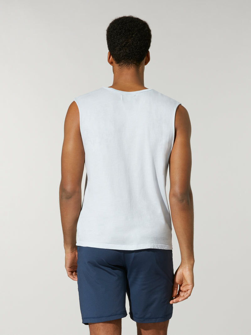 back view of male model in light blue muscle tank with Barry's written in blue and white stripe across chest