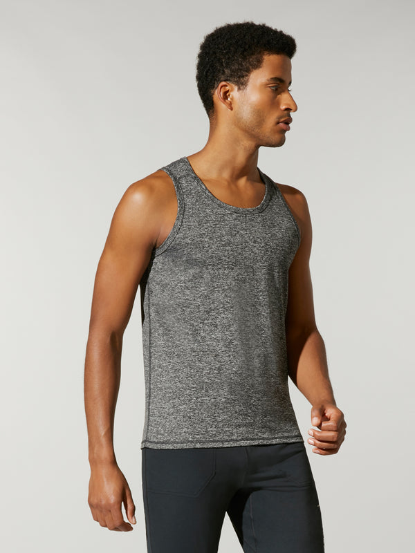 side shot of model wearing a Heather Grey FIT A/C TANK