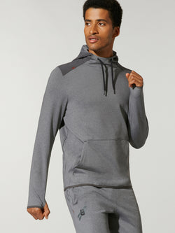 front view of male model in high neck grey sweat and matching grey sweatpants