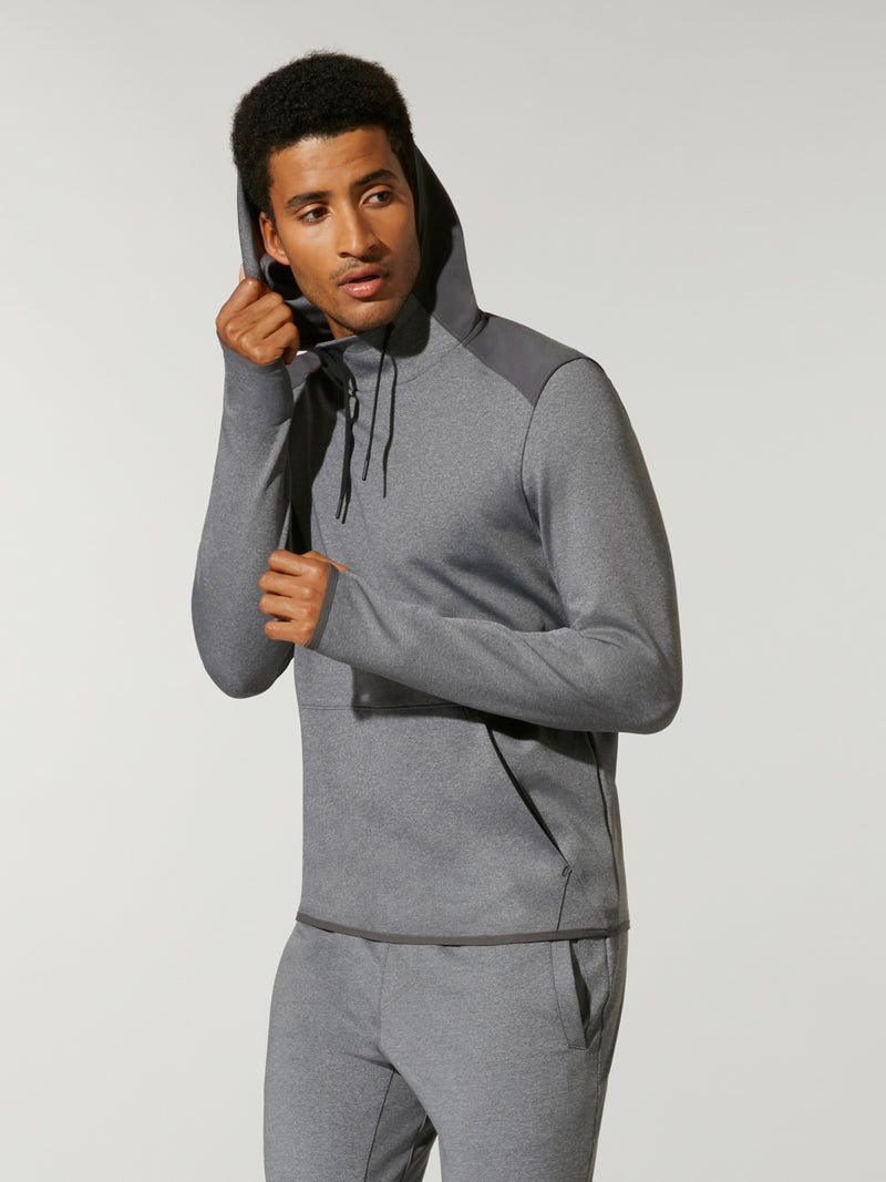 side view of male model in high neck grey sweat and matching grey sweatpants