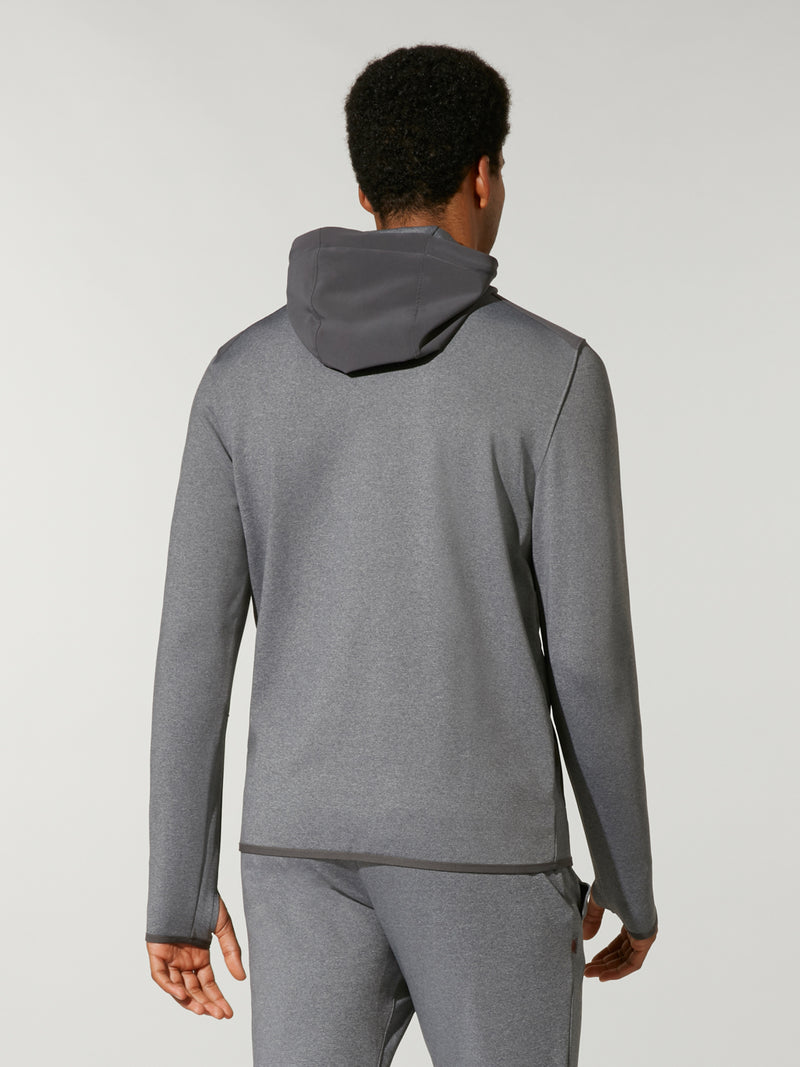 back view of male model in high neck grey sweat and matching grey sweatpants