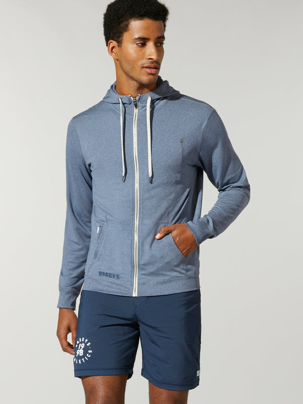 front view of male model in light navy blue zip up hoody and navy blue shorts