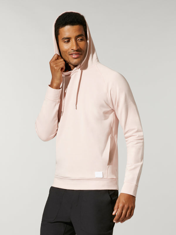 front view of male model in light pink sweatshirt and black shorts