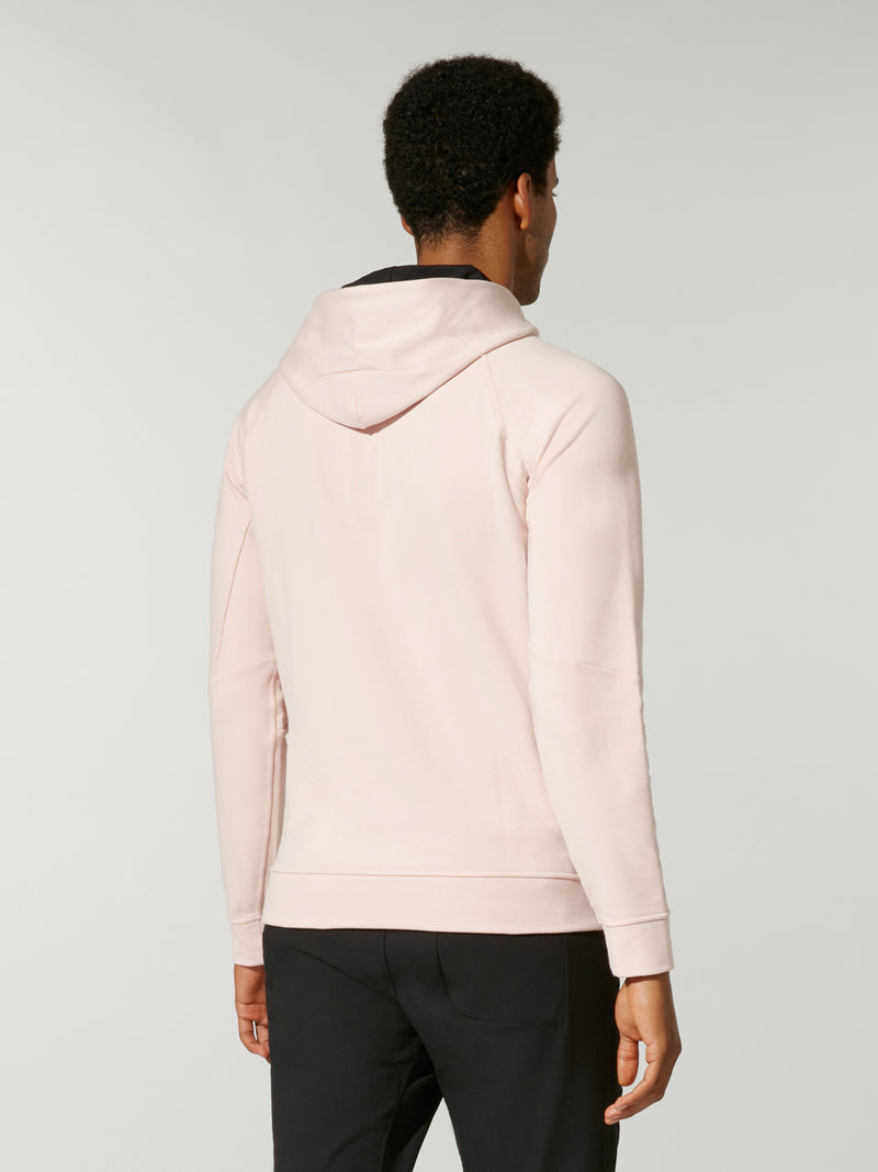 back view of male model in light pink sweatshirt and black shorts