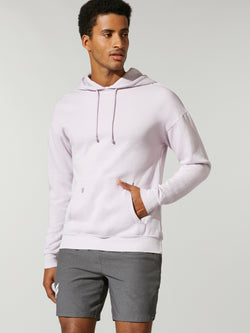 front view of male model in lavender fleece hoodie and grey shorts with hand in front pocket