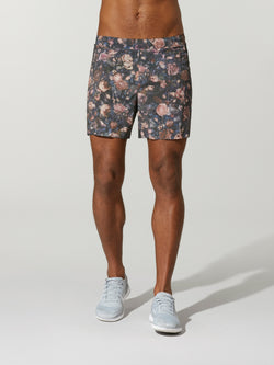 front view of shirtless male model in grey shorts with rose print