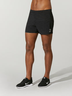 front view of male model in black workout shorts and black sneakers