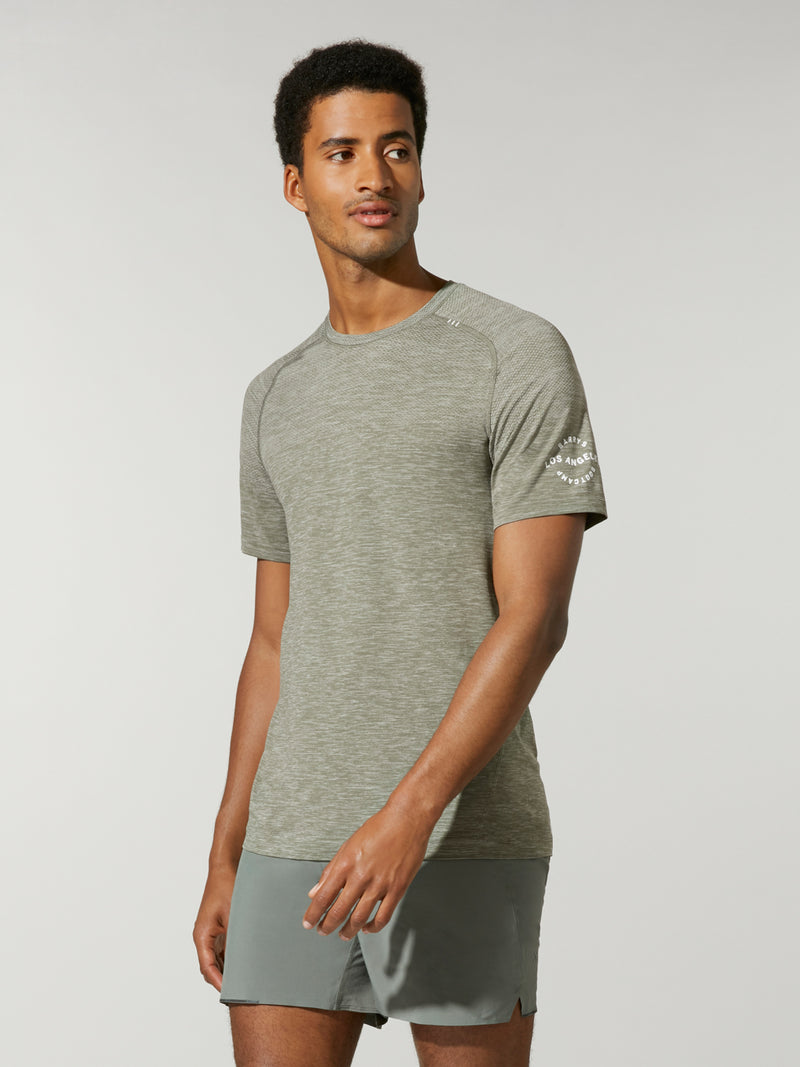 front view of male model in heather green t-shirt and matching athletic shorts