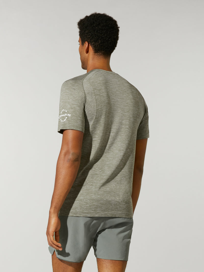 back view of male model in heather green t-shirt and matching athletic shorts