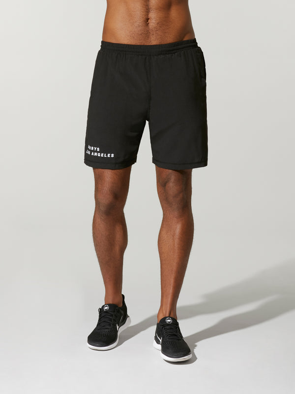 shirtless male model wearing black barry's bootcamp athletic short