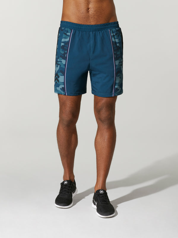 Front shot of model wearing blue camo FIT CAMO JOEY SHORT