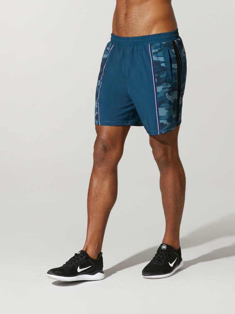 side shot of model wearing blue camo FIT CAMO JOEY SHORT