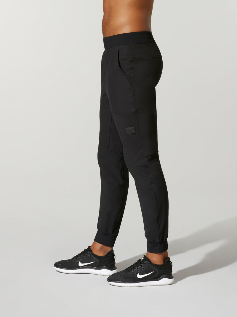 Side view of model wearing black joggers