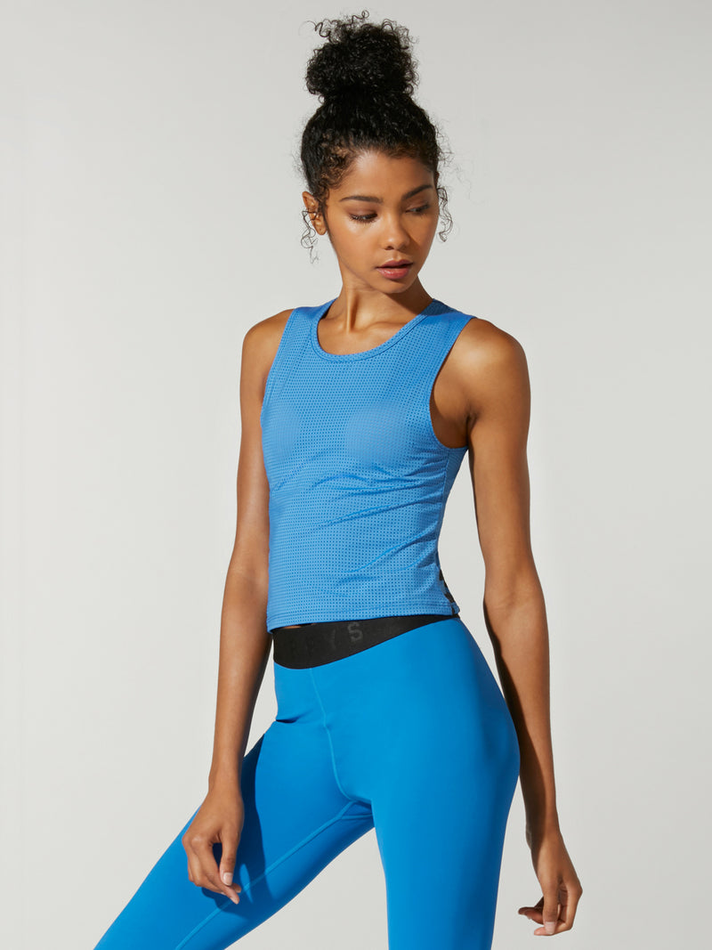 Front shot of model wearing bright blue FIT LIGHTNING CROP INTERVAL TANK
