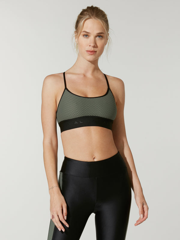 Model wearing olive-colored bra with black under-elastic.