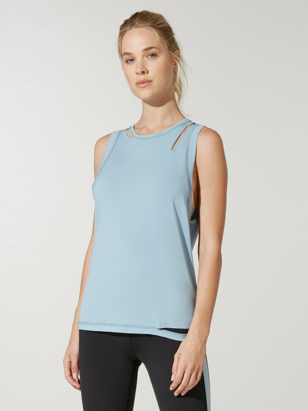 front view of model in light blue alala carve muscle tank top and dark leggings