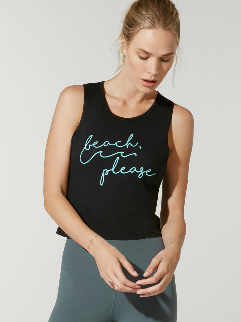 "front view of model in black cropped tank top with phrase ""beach, please"" in teal cursive lettering and teal leggings"