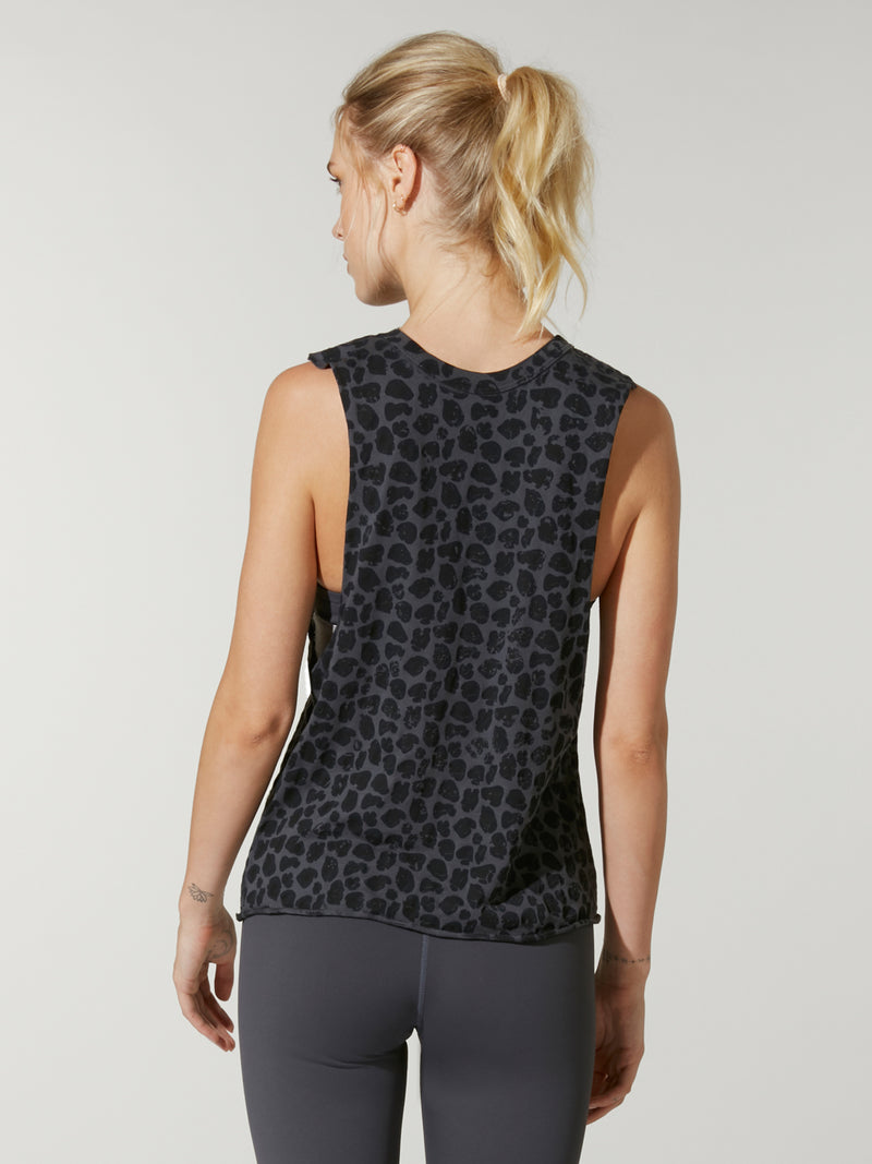 back view model wearing grey and black leopard print tank top with Barry's written on chest and grey leggings