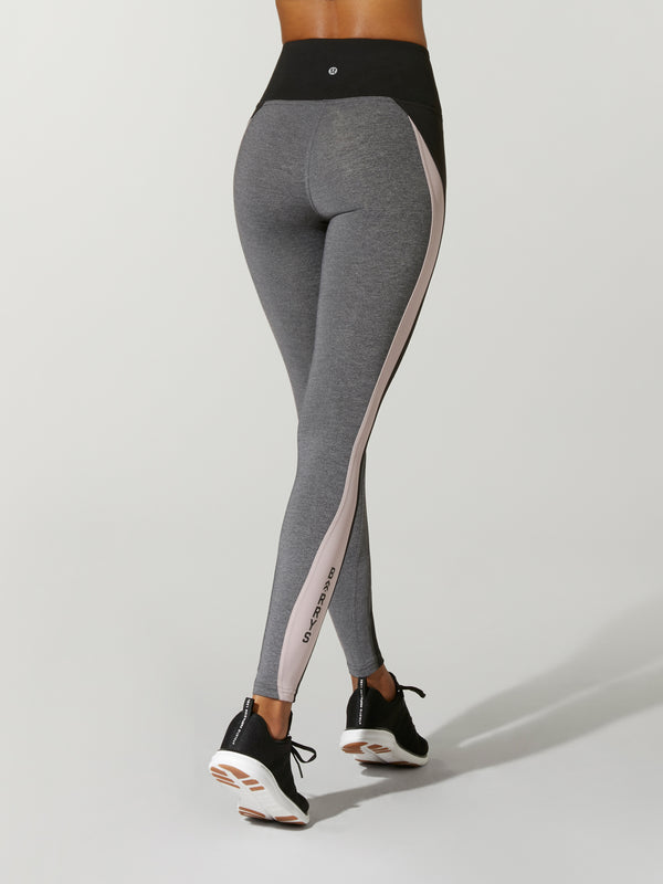 Back view of model wearing gray leggings