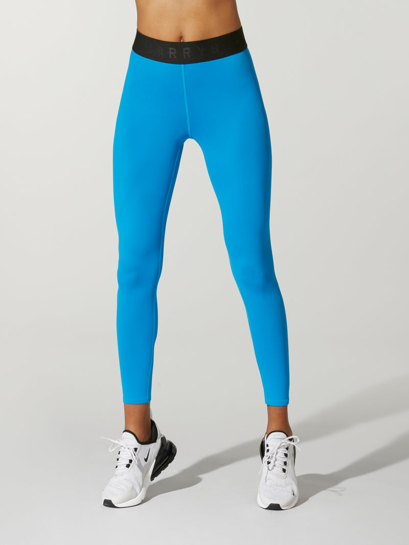 Front shot of model wearing bright blue FIT LIGHTNING SPRINTER TIGHT with black waist band