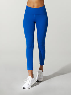 front view of model in royal blue leggings and white sneakers