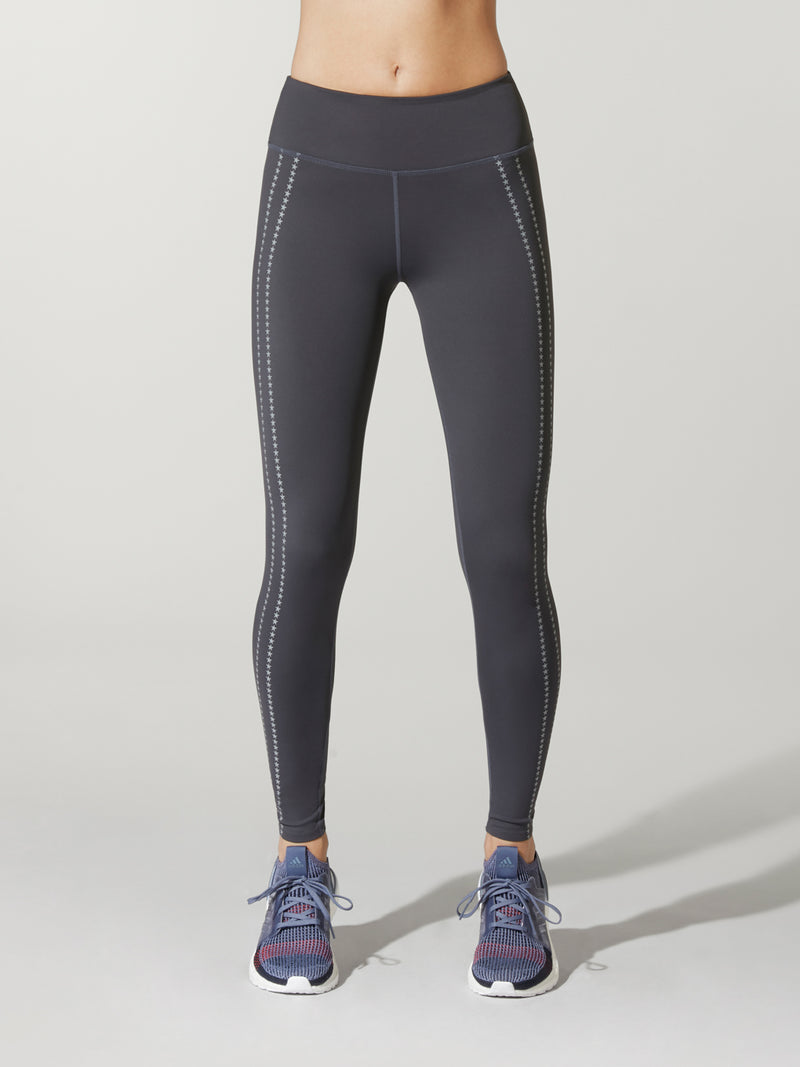 Front shot of model wearing dark grey FIT SPEED STORM HIGH WAIST TIGHTs