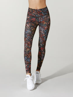 9cc99529a front view of model in black leggings with floral print and white sneakers