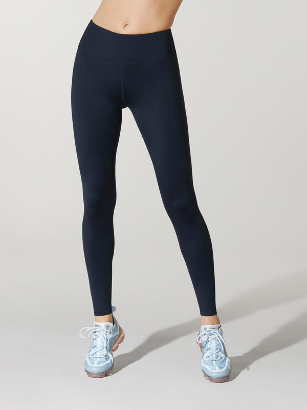 Front shot of model wearing very dark blue FIT MIDNIGHT HIGH WAIST SPEED TIGHTs