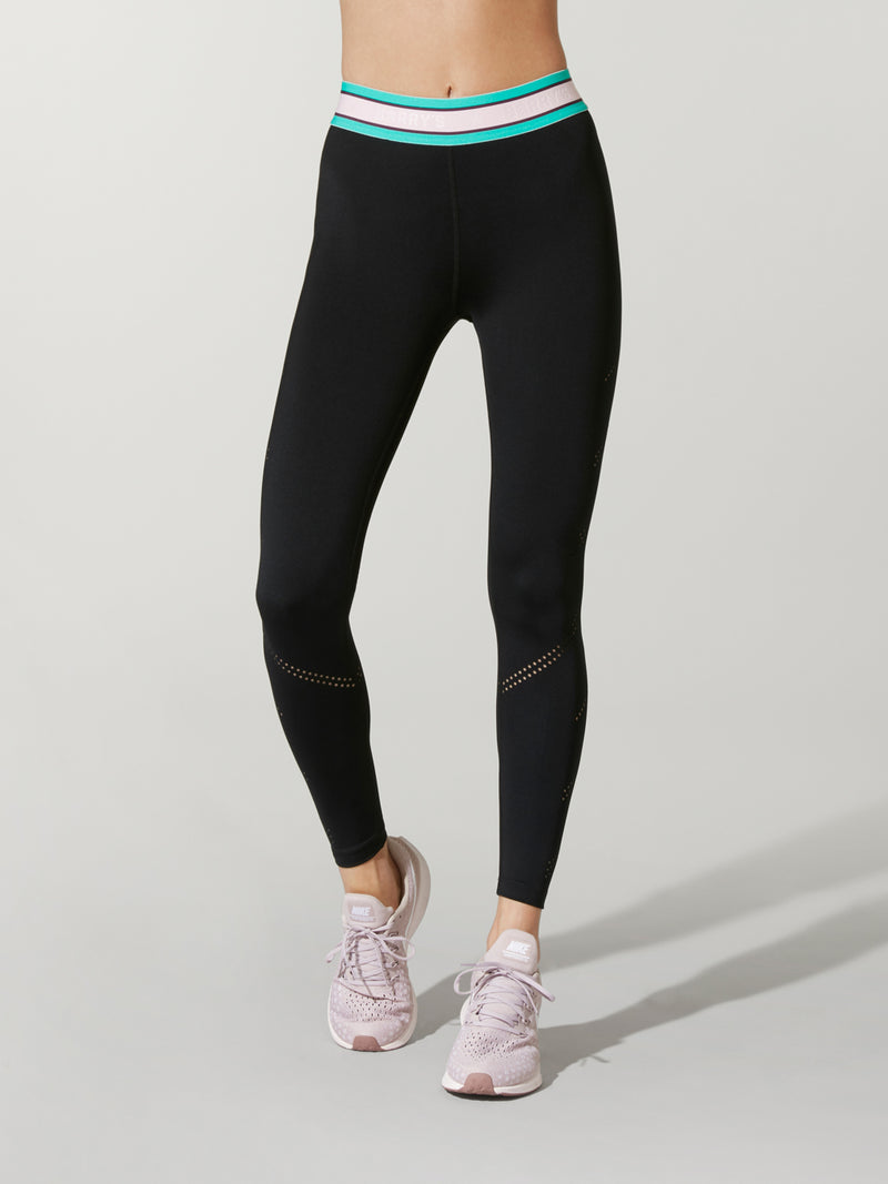 front shot of model wearing FIT LASER CUT SPRINTER TIGHTs in black with blue and pink waist band