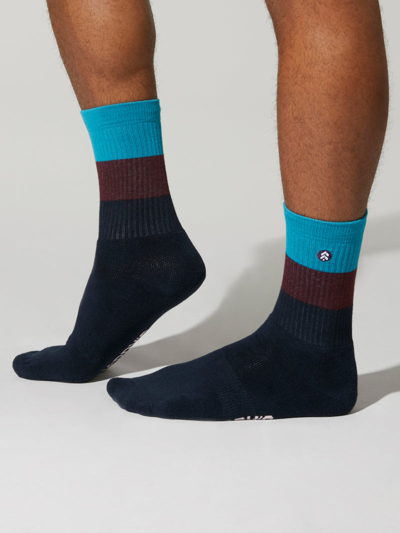 black red and blue striped socks on feet