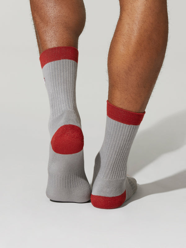 grey socks with red accents on toes heels and tops