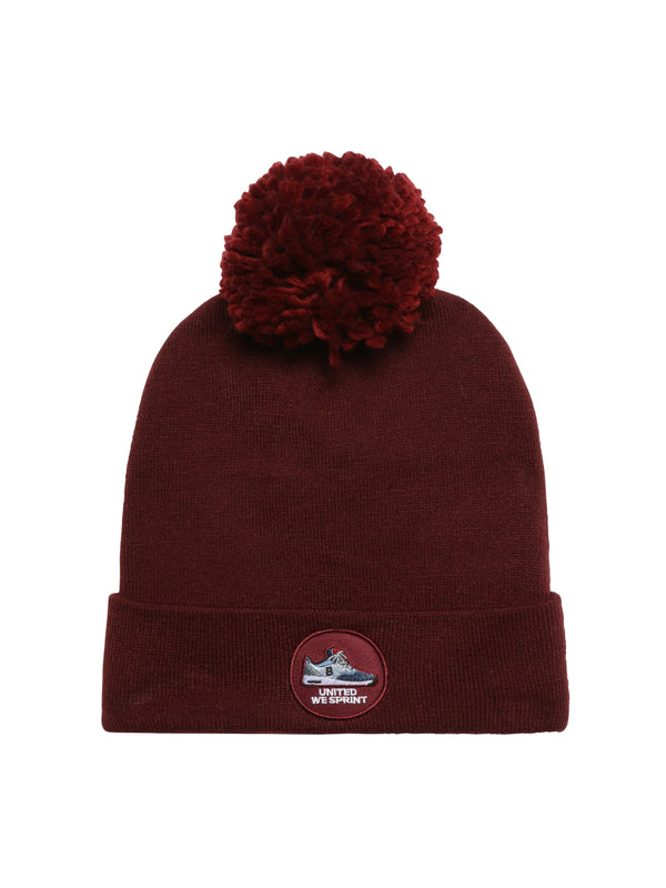 dark red beanie with pom pom on top