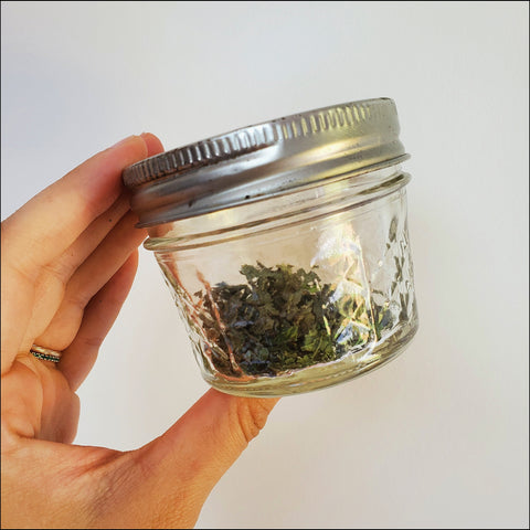 dried smokable herbs in a glass jar