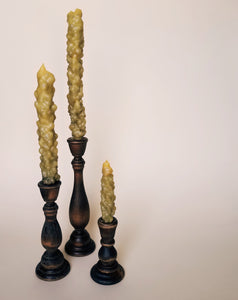 three mullein stalk beeswax candles in wooden candlesticks