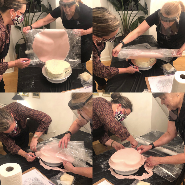 Applying rolled buttercream to cake