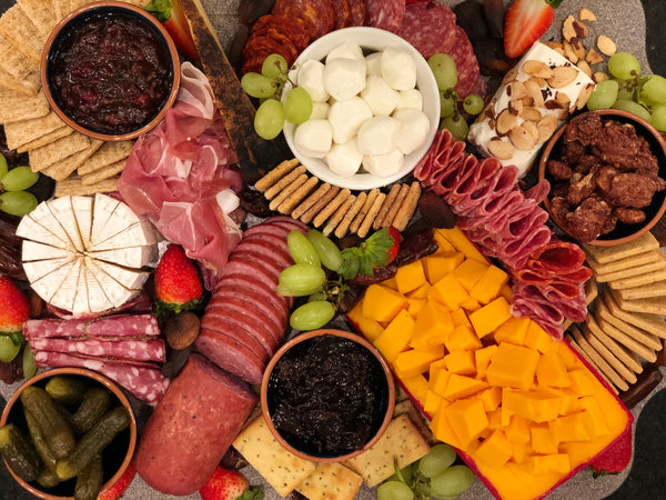 Charcuterie board with meats and cheeses