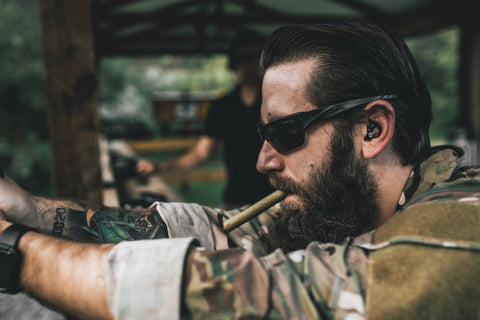 a man in camo with a cigar