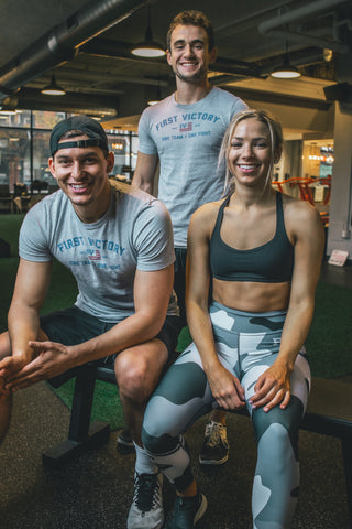 three fitness people smiling