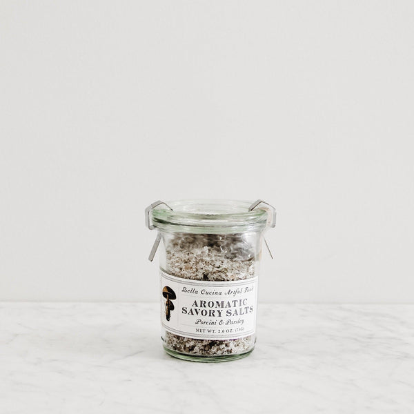 glass jar of aromatic mushroom flavored savory finishing salts