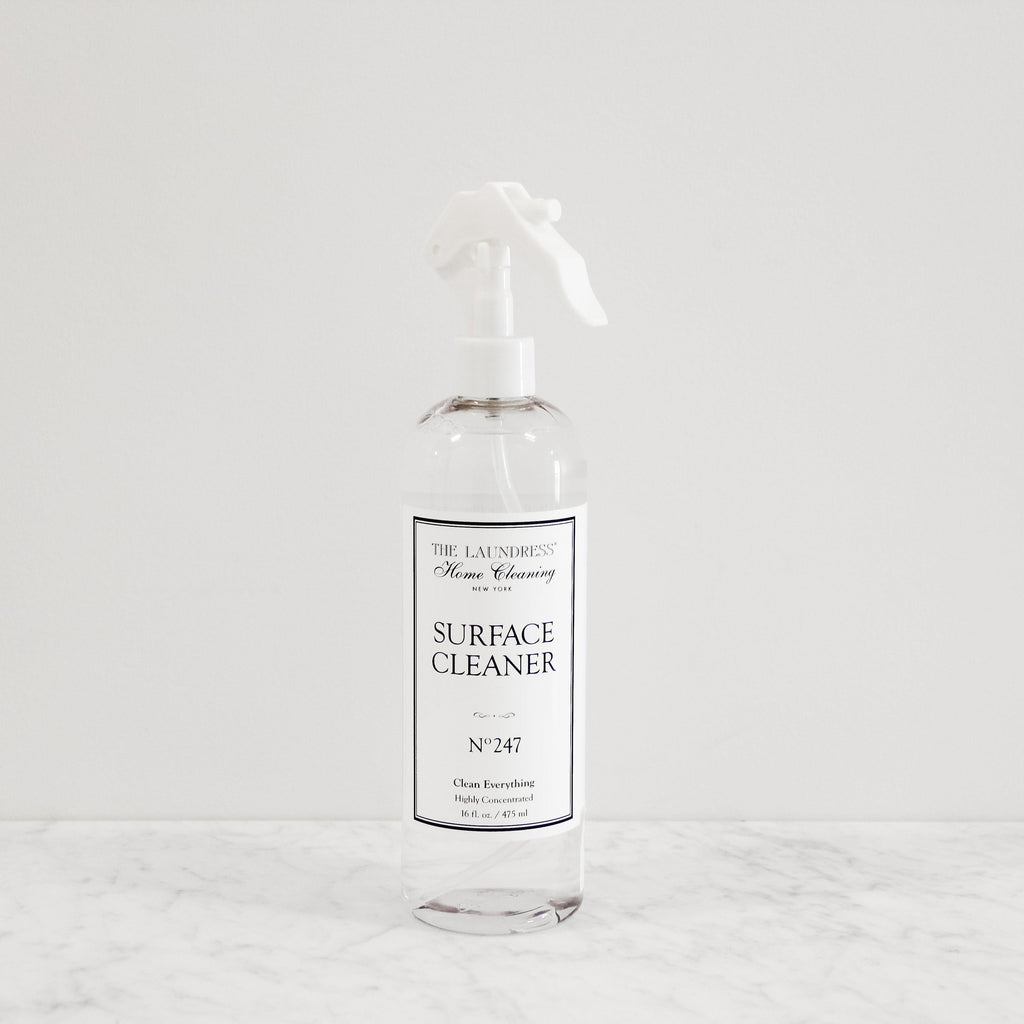 squeeze bottle of the laundress perfume scented surface cleaner solution