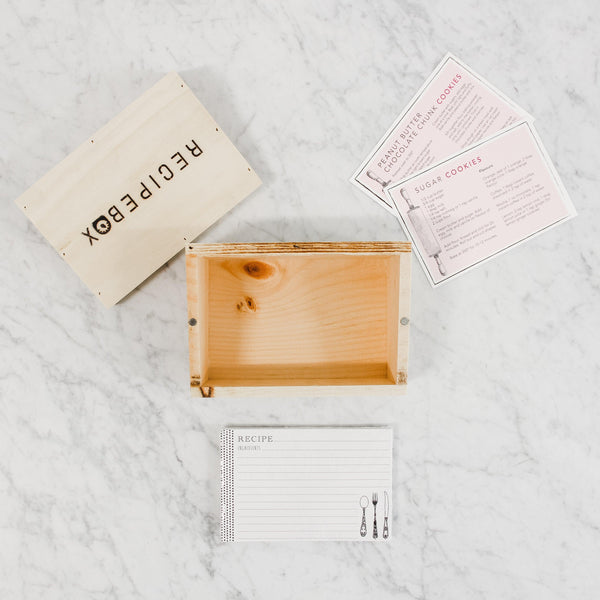 top view of open wooden recipebox by piebox with recipe cards
