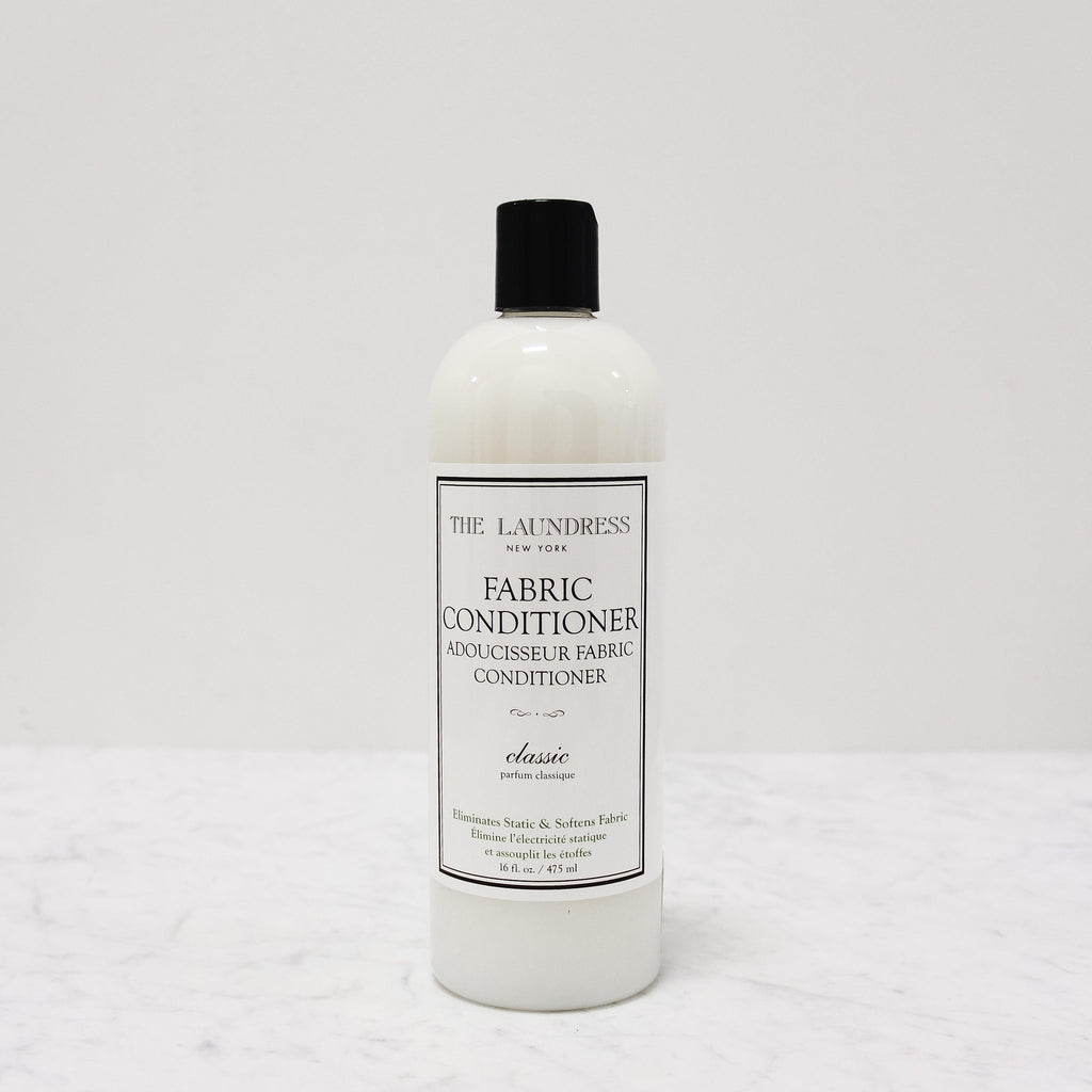 bottle of laundress classic fabric conditioner scented in classic perfume