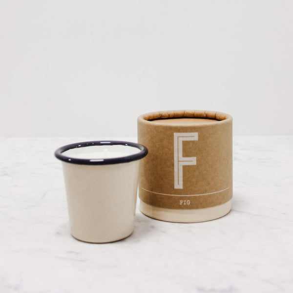 enamel cup with scented candle inside