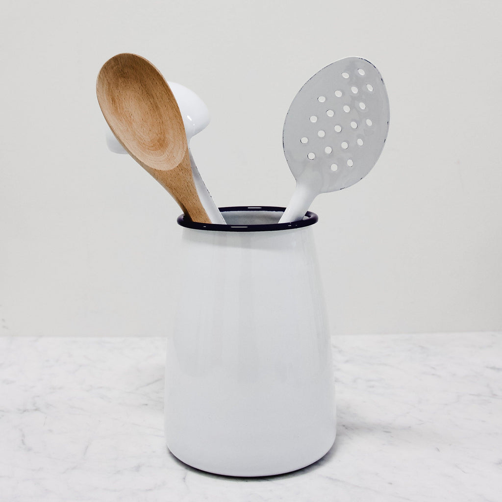 white enamel utensil pot with displayed utensils