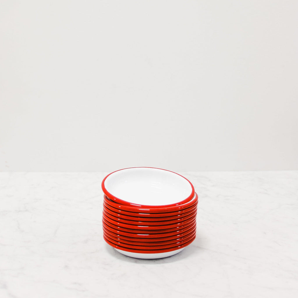 stack of red enamel tapas plates from Falcon Enamelware