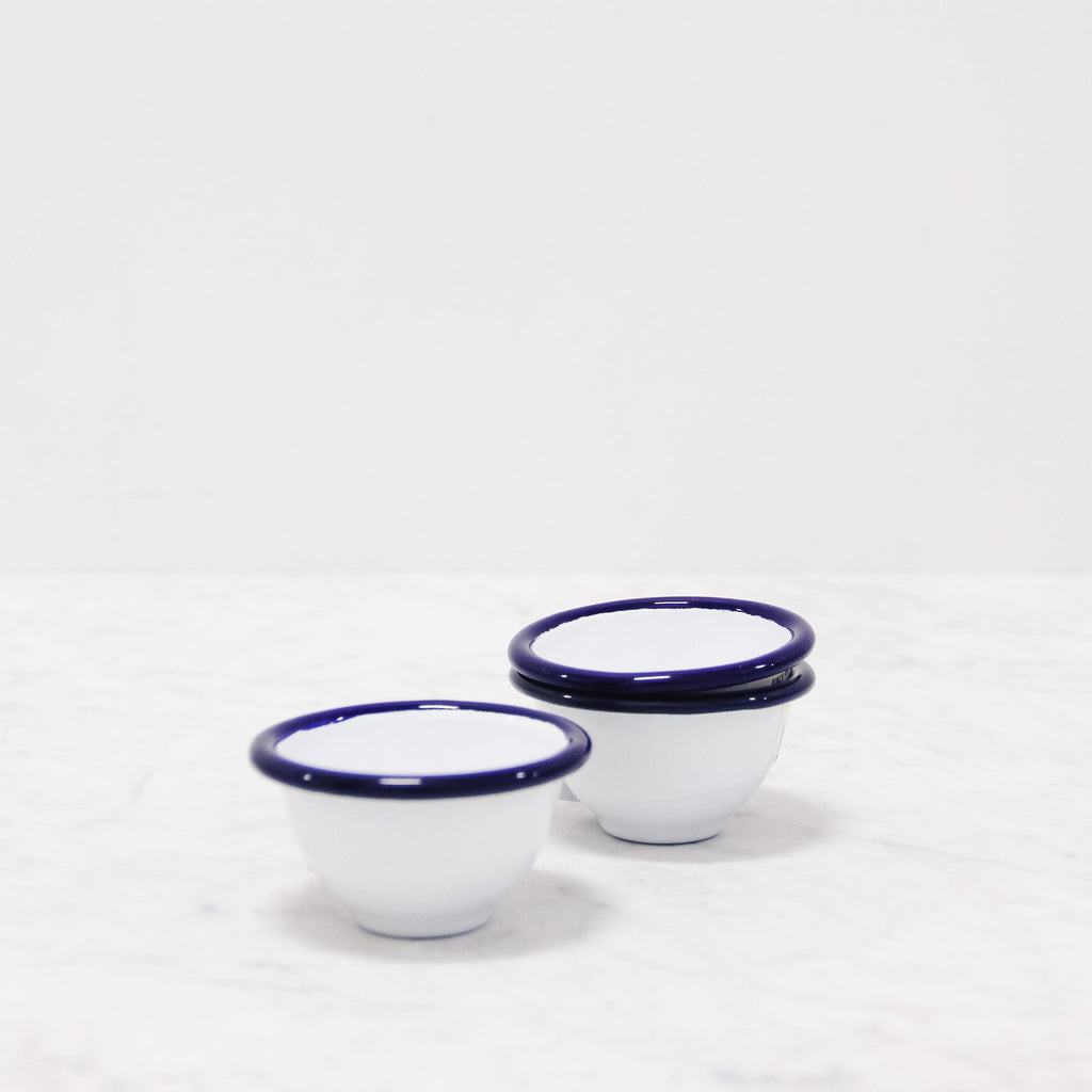 stack of white enamel pinch pots from Falcon Enamelware