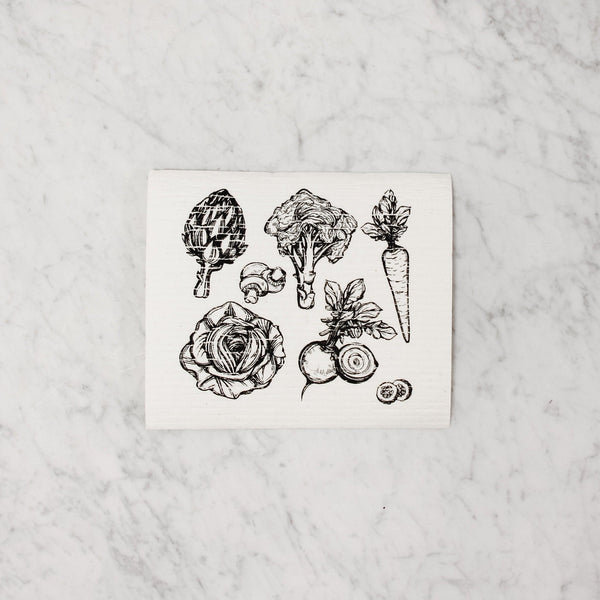 square swedish dish cloth with black and white cartoon vegetables (artichoke, mushroom, broccoli, carrot, beat, cabbage)