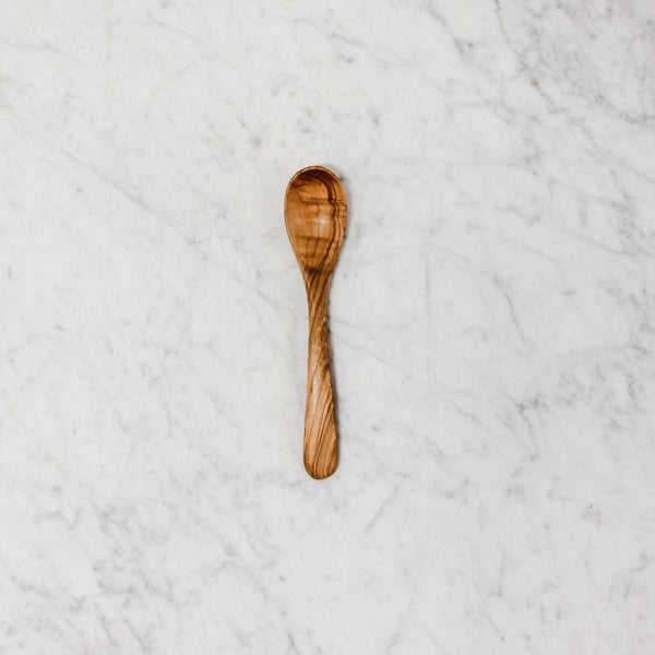 "top view of a 7"" olive wood spoon"