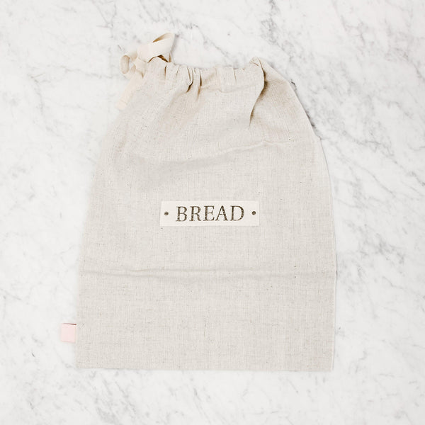 "top view of a flax cotton bread bag that says ""bread"" on the front"